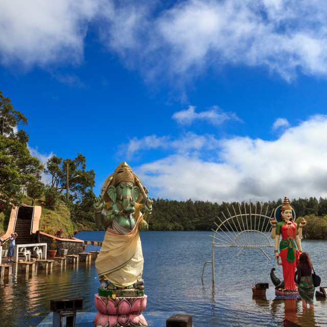 """Statues of Hindu deities Lord Ganesh and Goddess Ganga outisde temple on the sacred lake of Grand Bassin, Mauritius. Grand Bassin, also known as 'Ganga Talao' by Hindus, is a volcanic crater lake situated in the south west of the island of Maurities at ar"" stock image"