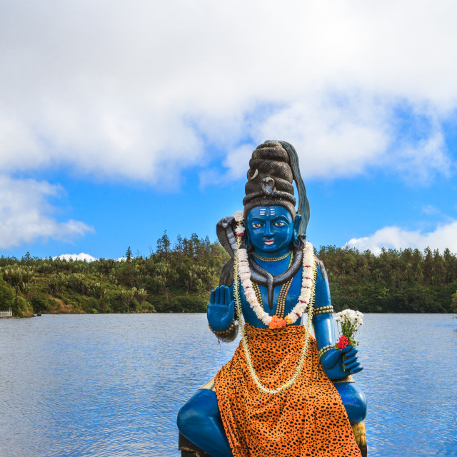 """Statue of Hindu god Lord Shiva outside temple on the sacred lake"" stock image"