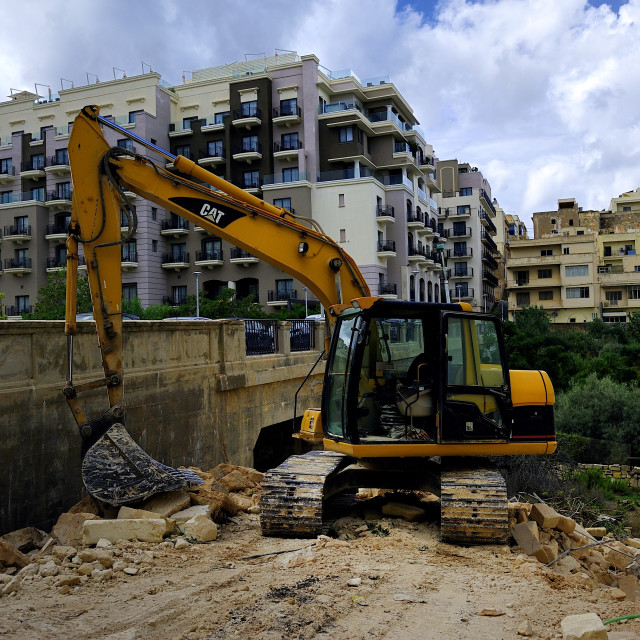 """Excavator and the demolition site"" stock image"