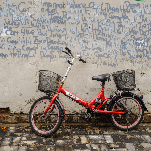 """Bicycle and graffiti wall in Beijing Hutong"" stock image"