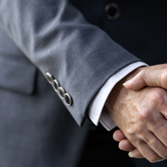 """Business deal mergers and acquisitions"" stock image"