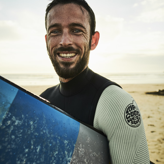 """A surfer on a beach portrait"" stock image"