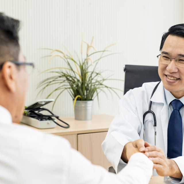"""Doctor portrait in medical office"" stock image"