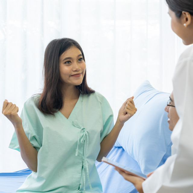 """Doctor explain treatment to patient"" stock image"