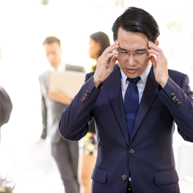 """Asian Businessman strain and got pressured"" stock image"
