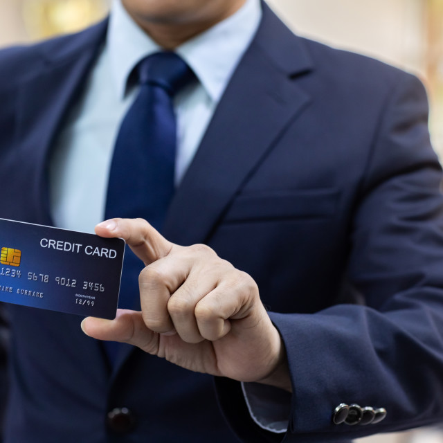 """Businessman hold credit card"" stock image"