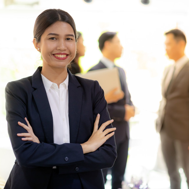 """asian businesswoman with business team"" stock image"