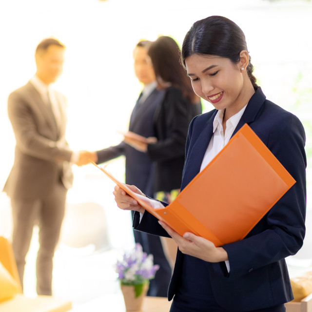 """Asian Businesswoman hold working file"" stock image"