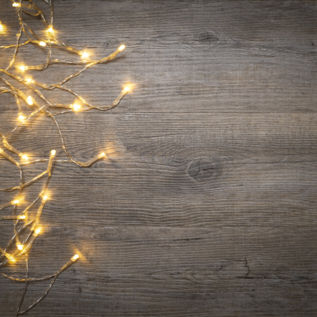 """""""flat lay of fairy lights on a wooden board with copy space"""" stock image"""