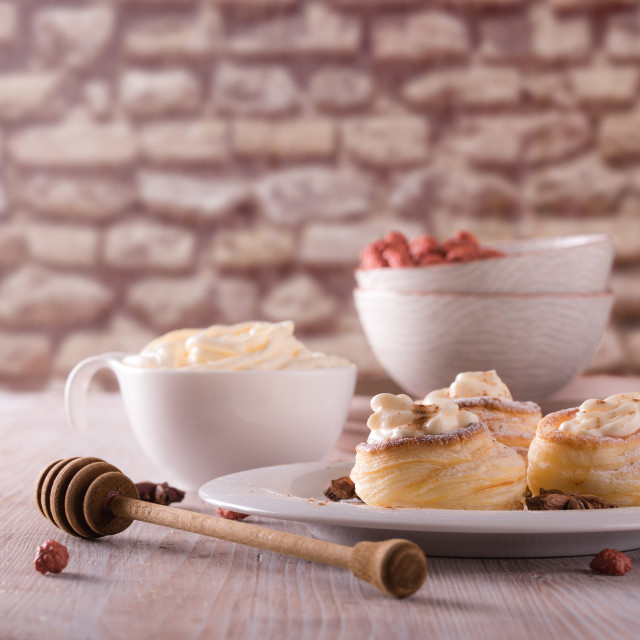 """Sweet dessert from puff pastry filled by curd cheese on wooden board"" stock image"
