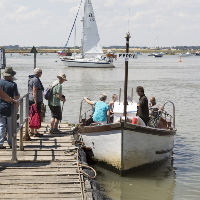 """""""Passengers boarding River Deben foot passenger ferry boat at Bawdsey Quay,..."""" stock image"""
