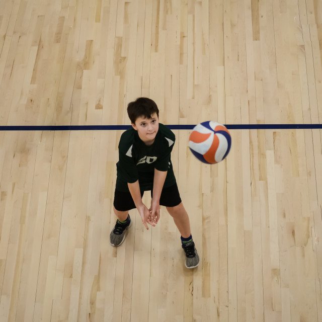 """Young volleyball player passing the ball"" stock image"