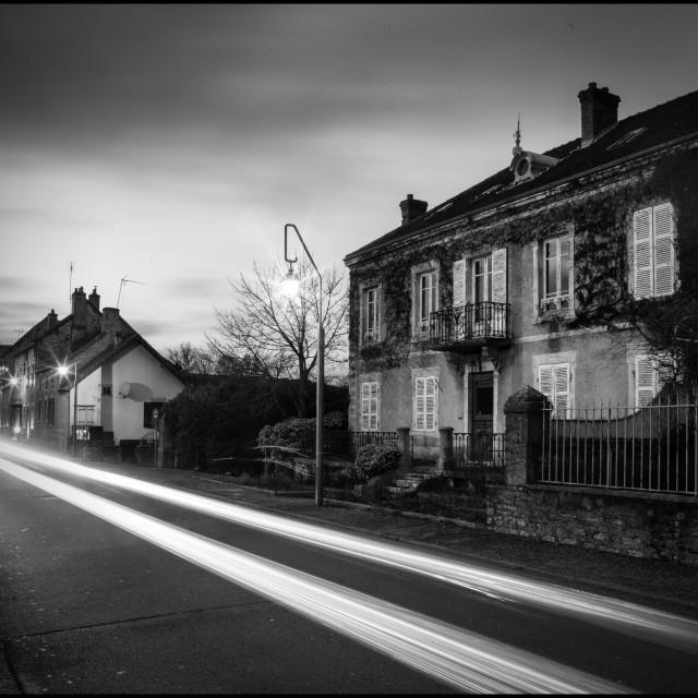 """Evening Street Scene in Burgundy"" stock image"