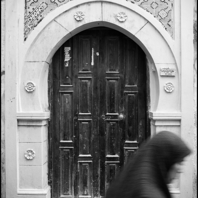 """""""Woman and door in Liby"""" stock image"""