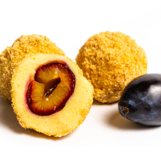 """Bread crumb dumplings with plums isolated"" stock image"