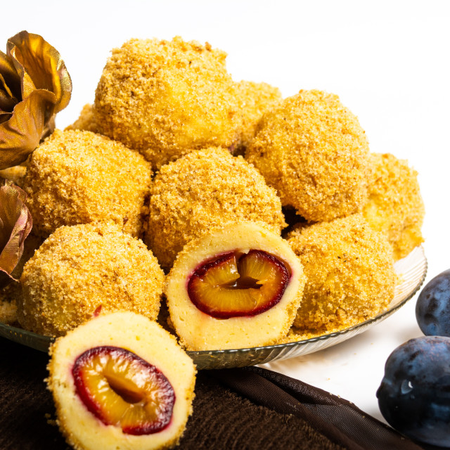 """Bread crumb dumplings with plums on a plate"" stock image"