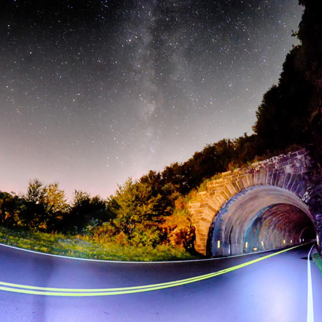 """""""The Craggy Pinnacle Tunnel, on the Blue Ridge Parkway in North Carolina at night"""" stock image"""