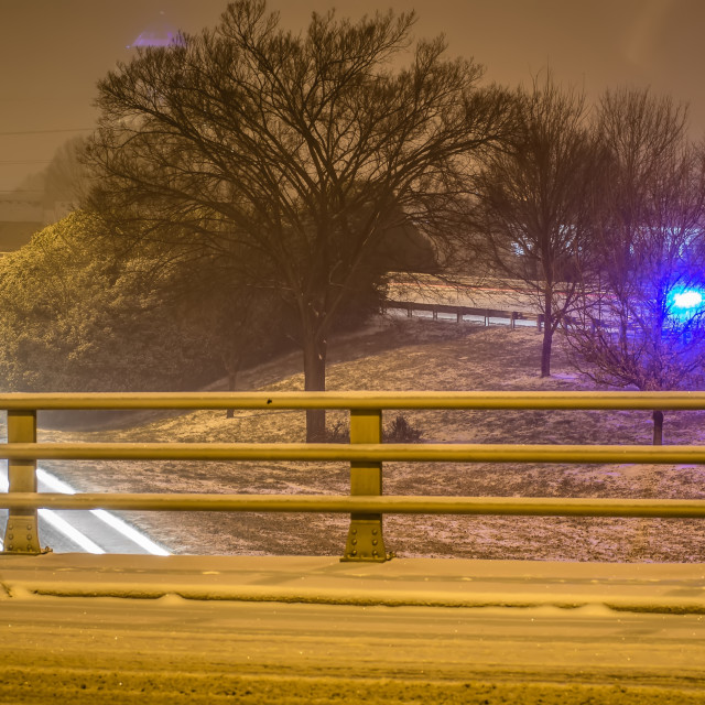 """police helping injured driver after a crash during winter snowstrom in the south"" stock image"