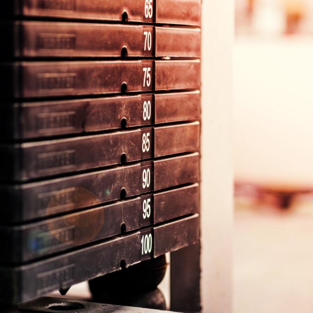"""Stack of rusty metal weights in gym bodybuilding equipment"" stock image"