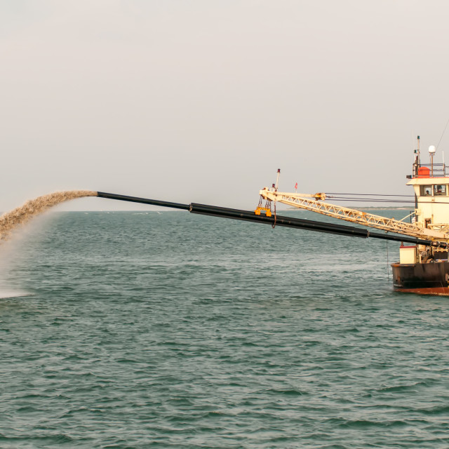"""Barge Pipe pushing sand onto the beach"" stock image"
