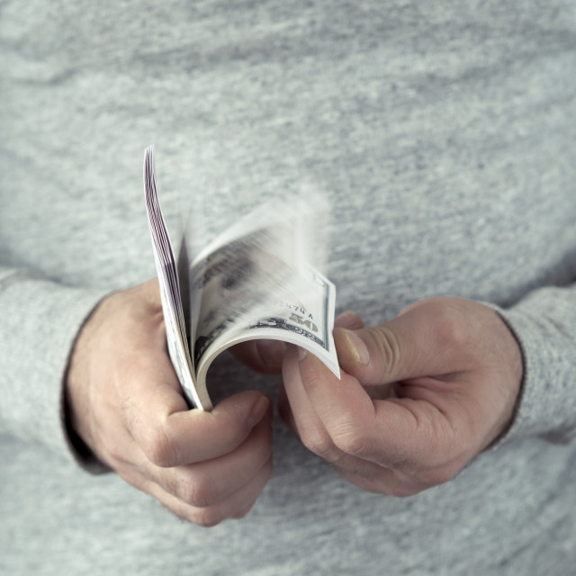 """""""Hands counting dollars"""" stock image"""