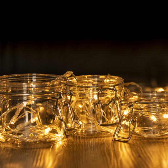 """glass mason jars with fairy lights"" stock image"
