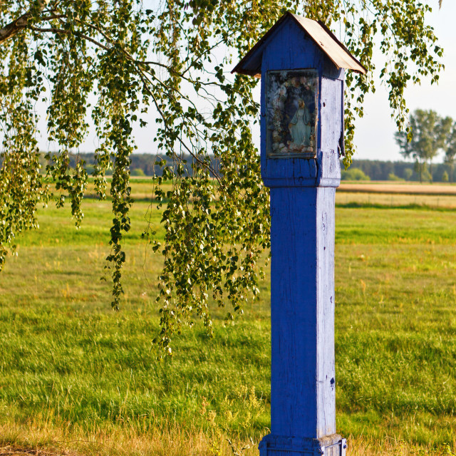 """""""Old blue chapel on the green field"""" stock image"""