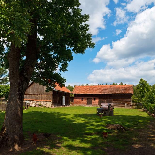"""Idyllic countrysie farm under blue cloudy sky"" stock image"
