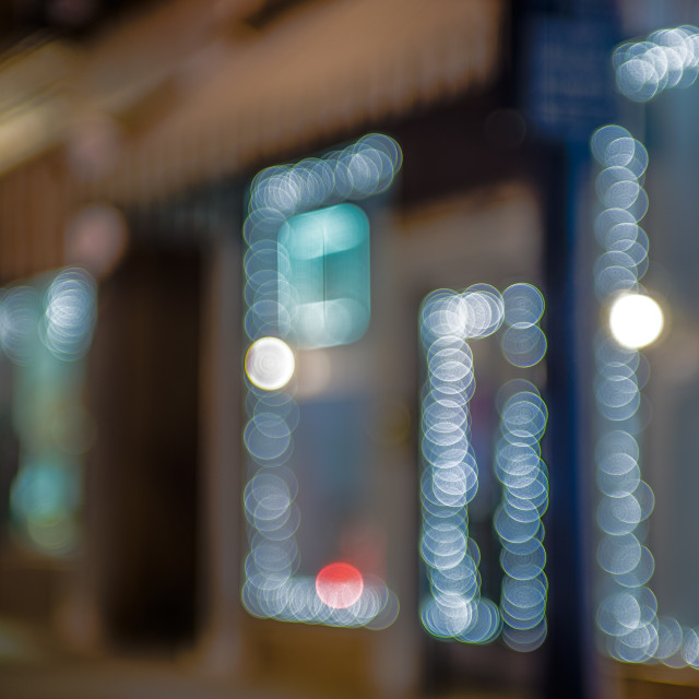 """defocused storefront sidewalk lights at night"" stock image"