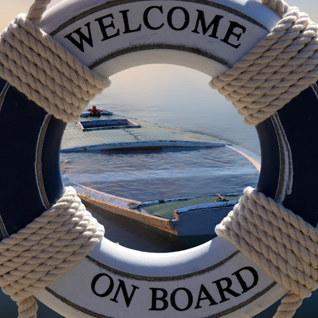 """wellcome safe belt and sinking boat"" stock image"