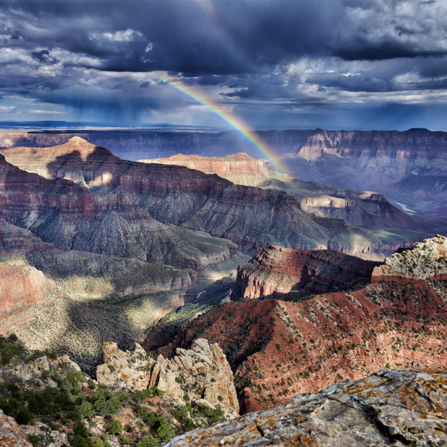 """""""dramatic clouds and rainbow over Grand Canyon"""" stock image"""