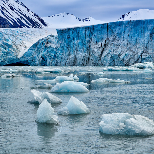 """blue ice of glacier Dahlbreen on Svalbard"" stock image"