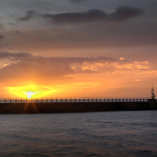 """Daybreak at Swansea's East Pier"" stock image"