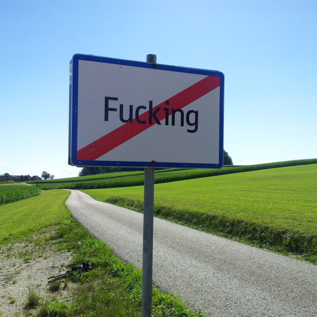 """Exit sign from the village of Fucking, Tarsdorf, Upper Austria, Austria"" stock image"