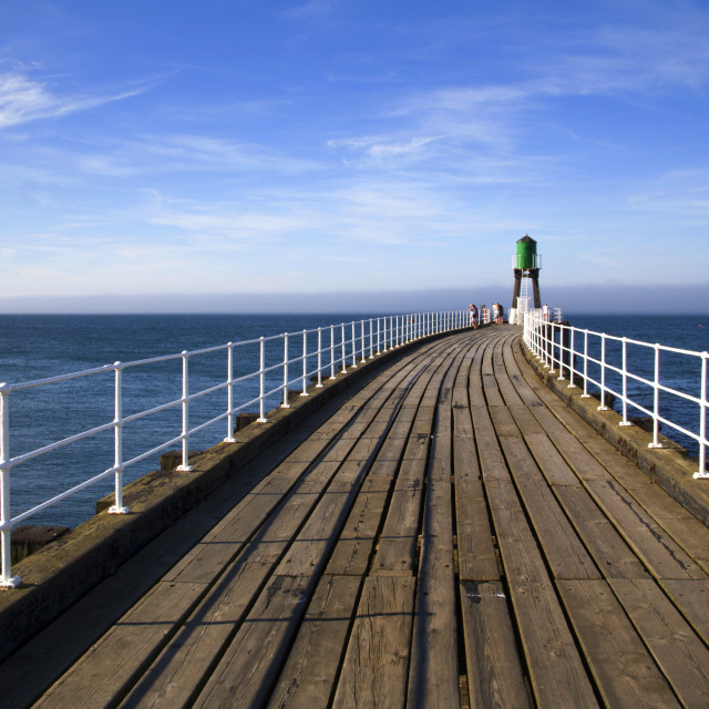 """""""People Enjoying The View From The West Pier at Whitby North Yorkshire England"""" stock image"""