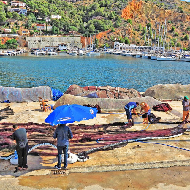 """""""Fishermen mending nets in Spain"""" stock image"""
