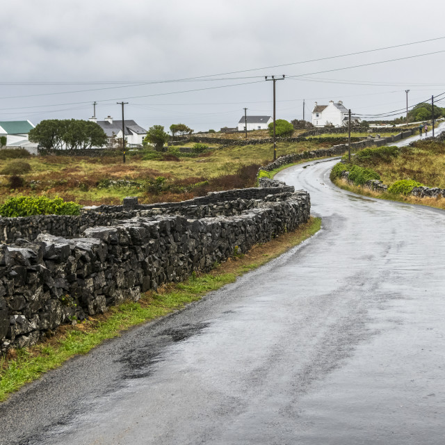 """""""A wet road in an Irish village on the West Coast of Ireland at the mouth of..."""" stock image"""