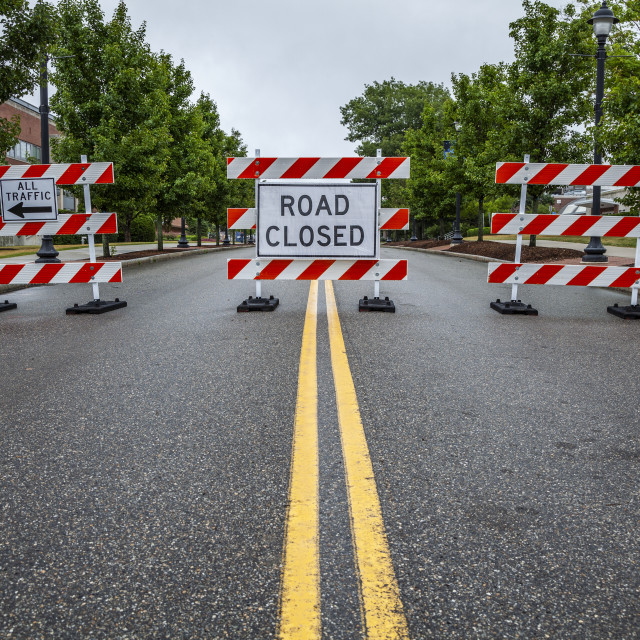 """""""Double yellow line on a street with traffic barriers and 'Road Closed' sign;..."""" stock image"""