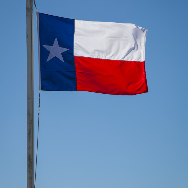 """""""Texas state flag in a blue sky; Galveston, Texas, United States of America"""" stock image"""