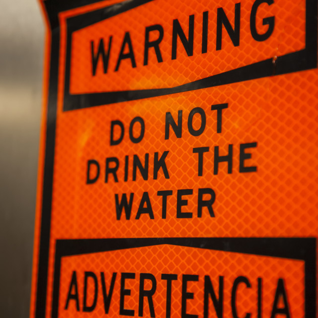 """""""An orange sign warning 'do not drink the water'; Galveston, Texas, United..."""" stock image"""