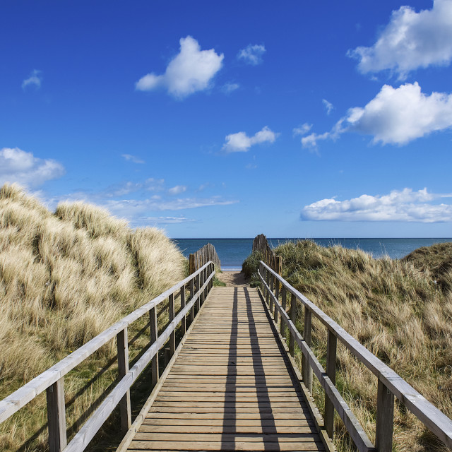 """""""Walkway on West Sands Beach towards the blue ocean and horizon; St. Andrews,..."""" stock image"""