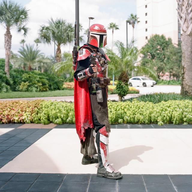 """Man dressed as Boba Fett pointing gun at camera during Star Wars Celebration..."" stock image"