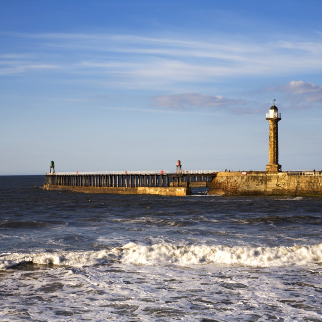 """West Pier and Lighthouse at Whitby"" stock image"