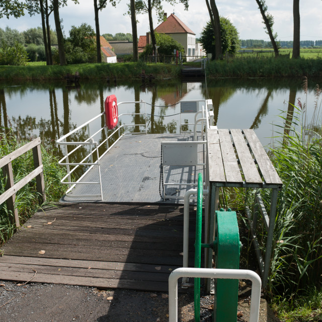 """""""Damme Belgium Hand ferry on the Damse Vaart canal."""" stock image"""