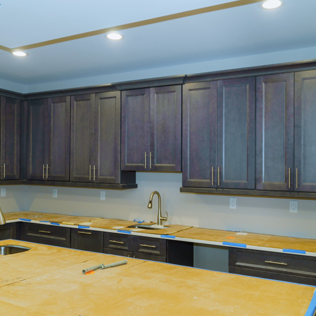 """""""Blind cabinet, island drawers and counter cabinets installed"""" stock image"""
