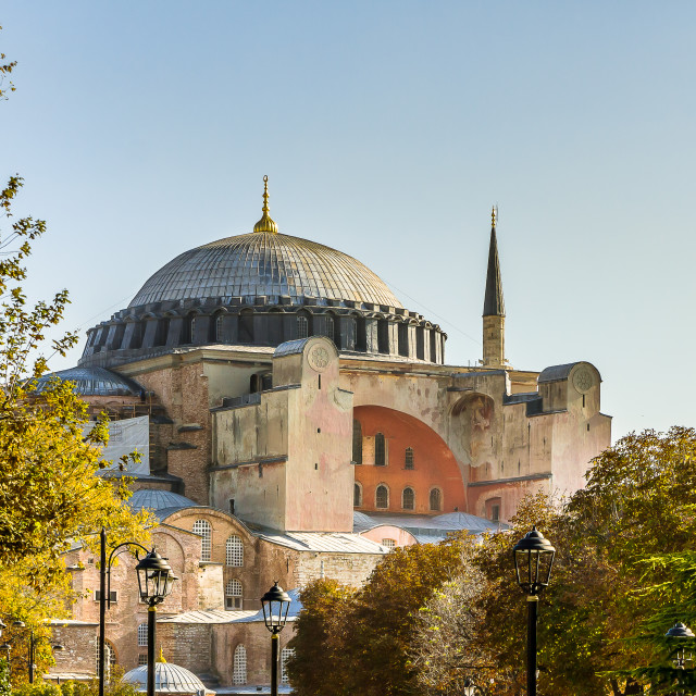 """Facade of Hagia Sofia and its cupola against the blue sky"" stock image"