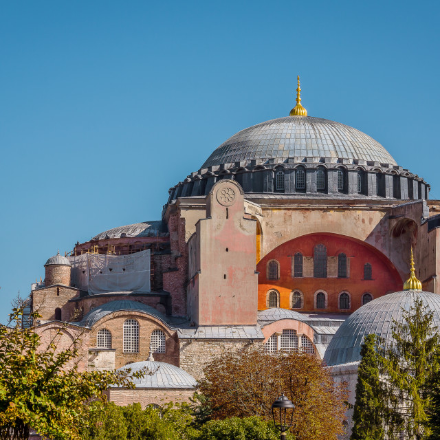 """Facade of Hagia Sofia and its refulgent cupola against the blue"" stock image"
