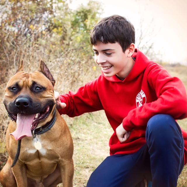 """Teenager and his dog"" stock image"