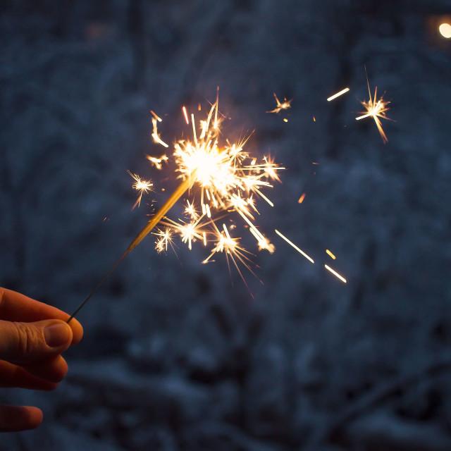 """Having fun with sparkler"" stock image"