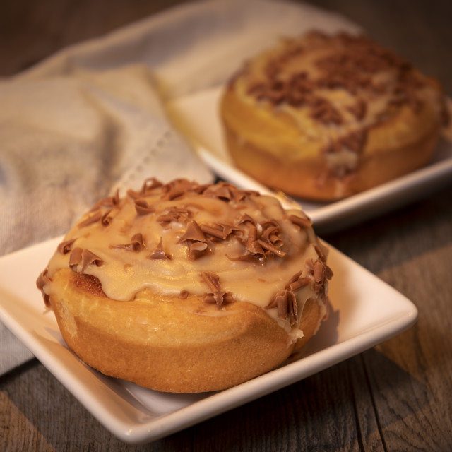 """""""sweet buns with cinnamon and chocolate icing on a wooden table"""" stock image"""